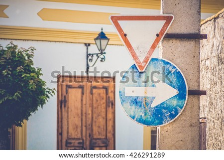 old traffic sign in a corner - stock photo