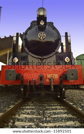 old train at the station, waits for passengers to board. Front view - stock photo