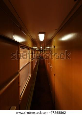 old Train carriage corridor urly morning light - stock photo