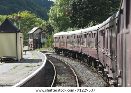 Old Train Carriages At A Station Platform - stock photo