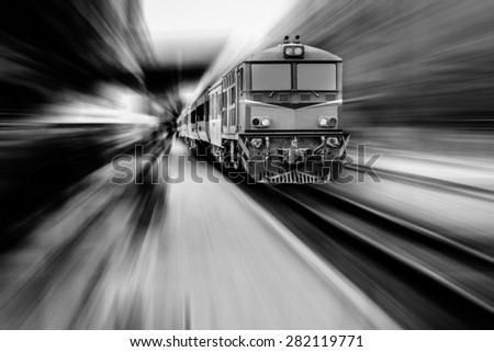 old train in a railway station with zoom - stock photo