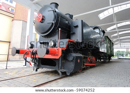 Old train in a shed. - stock photo