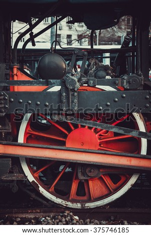 Old train red wheel, part of old,not in used, train standing in front of Belgrade railway station/Old train wheel - stock photo