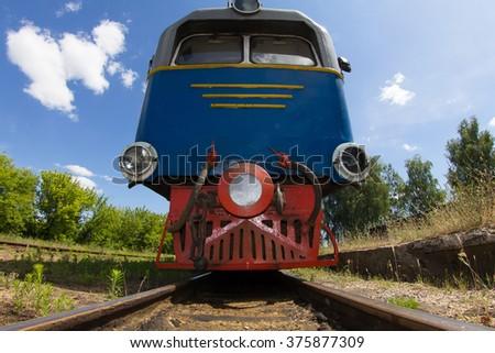 "Old train standing on old narrow rails; the narrow gauge railway of the Ukrainian Polissya which is called ""Polissya Tram"" or ""Kukushka"" - stock photo"