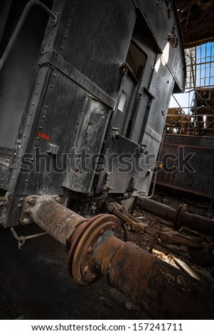 Old train wagons in an abandoned warehouse - stock photo