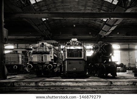 Old trains in abandoned depot parking - stock photo