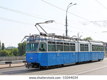 Old tram on a street - stock photo