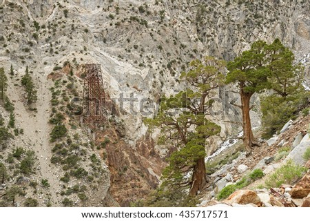 old tramway tower across Morgan Creek from some old trees - stock photo