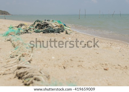 old trawl garbage on the beach