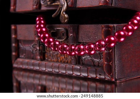 old treasure chest with jewelry  on black - stock photo