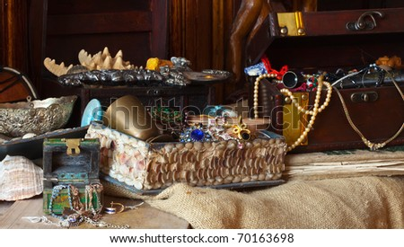 Old treasure chests with vintage gems and jewellery - stock photo