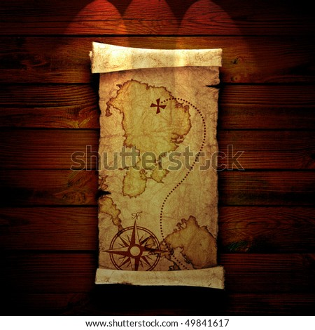 old treasure map on a wooden background - stock photo