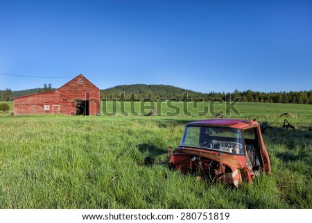 Old truck and barn south of Tensed, Idaho. - stock photo