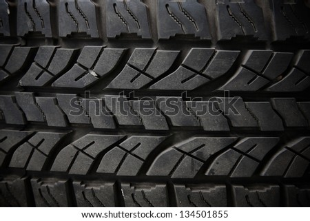 Old truck tire texture - stock photo