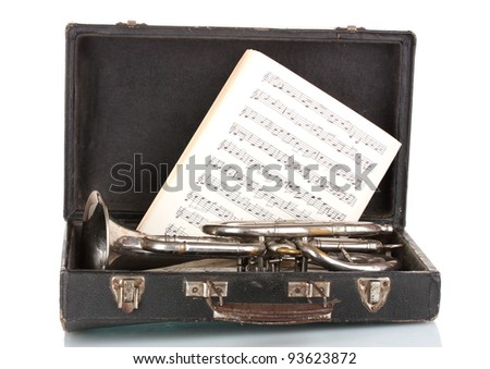 old trumpet and notebook with notes in case isolated on white - stock photo