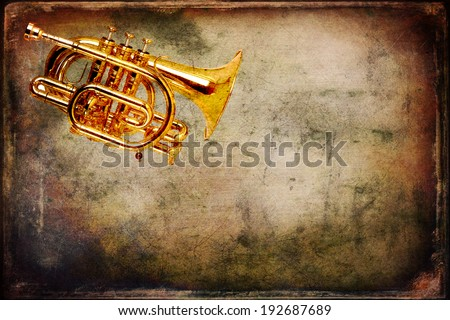 Old trumpet photo on the grunge background - stock photo