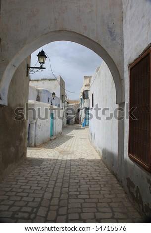 old tunisian city paved street - stock photo