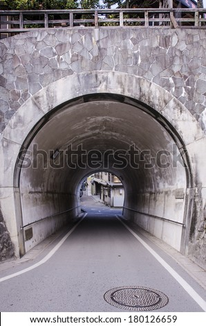 old tunnel made from a rock - stock photo