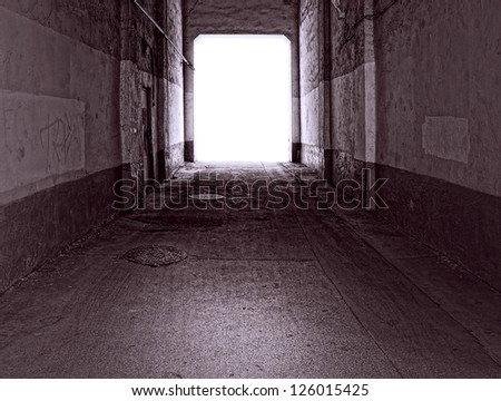 old tunnel  with light at the end - stock photo