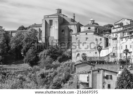 Old, Tuscan buildings in Sienna in Italy - stock photo