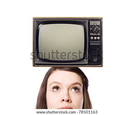 Old TV on the heads of young women. - stock photo
