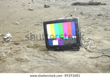 old tv playing color bars in desert .with path on screen - stock photo