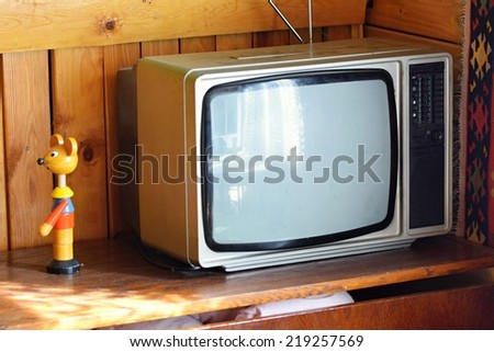 Old  tv. Retro style. Old household wooden background - stock photo