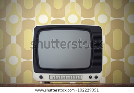 Old TV screen. on vintage background - stock photo