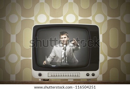 Old TV screen on vintage background. Anchorman on screen