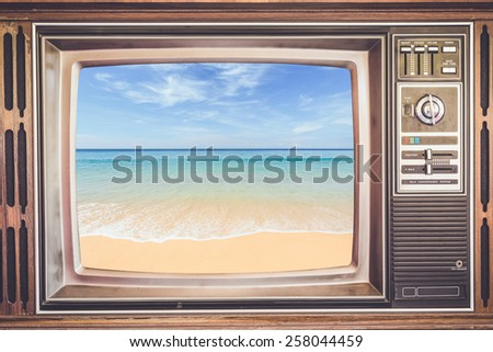 Old TV with tropical sea on screen, retro filter effect - stock photo