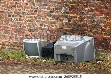 Old TVs dumped - stock photo