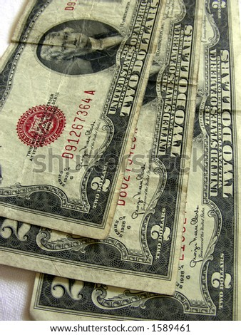 Old two dollar bills, US currency - stock photo