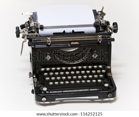 Old type writer with paper sheet - stock photo