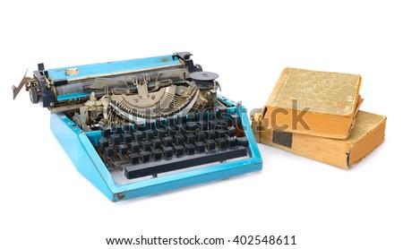 old typewriter and books isolated on white background - stock photo