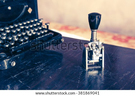 Old typewriter and rubber stamp - stock photo