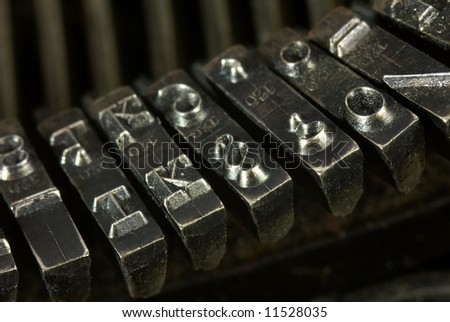 Old typewriter. Close up of metal letters.