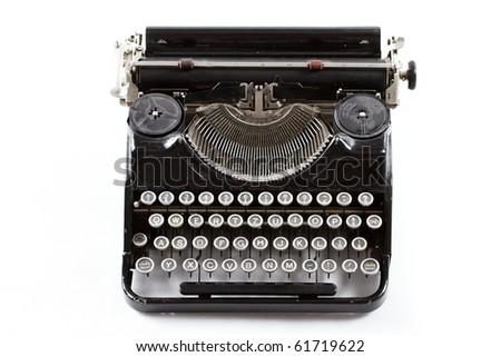 Old typewriter isolated on white - stock photo
