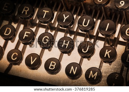 Old typewriter keyboard - Vintage image, noise and scratches - stock photo