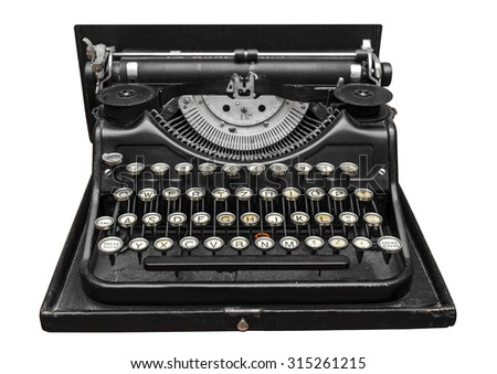 Old typewriter on a white background.