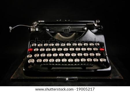Old typewriter on black background - stock photo