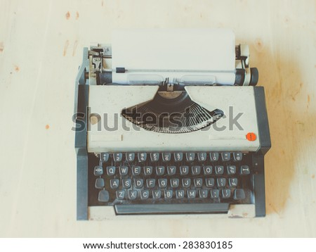Old Typewriter on wooden table.