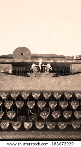 Old Typewriter - vertical with texture (artsy) - stock photo