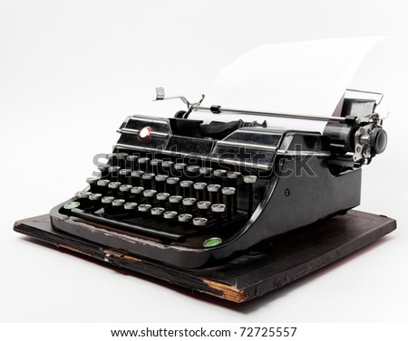 Old typewriter with a sheet of paper isolated on white background - stock photo