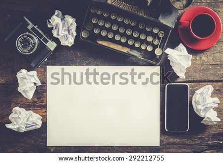 Old typewriter with blank paper, ready for jounalist action, a concept - stock photo