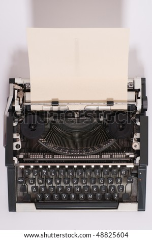 Old typewriter with paper in it - stock photo