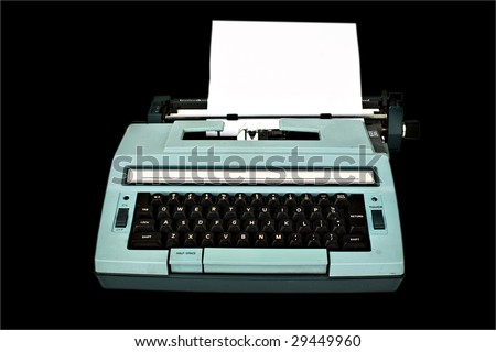 Old typewriter with paper isolated with clipping path over black background - stock photo