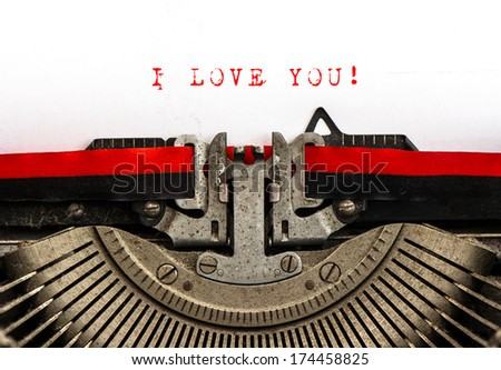 Old typewriter with sample text I LOVE YOU! Red words on white paper. Valentines Day card - stock photo