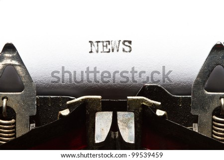 old typewriter with text news - stock photo