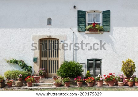 Old typical Tuscan house in Italy - stock photo