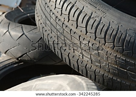 Old tyres in a waste pile - stock photo